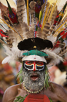 Man from Western Highlands Province..Superb Bird of Paradise on headdress..Goroka, Eastern Highlands Province, Papua New Guinea.