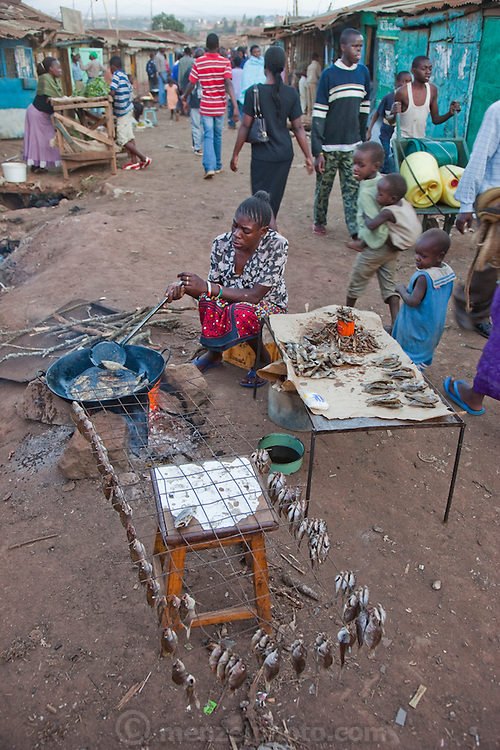 A vendor fries fish for sale in the Kibera slum, Africa's largest slum settlement with nearly one million inhabitants, the majority of whom have no access to running water and ablution facilities.