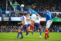 Matthew Clarke of Portsmouth heads the ball under pressure - Mandatory by-line: Jason Brown/JMP - 03/09/2017 - FOOTBALL - Fratton Park - Portsmouth, England - Portsmouth v Rotherham United - Sky Bet League Two