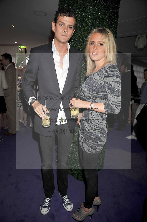 The HON.ALI SPENCER-CHURCHILL and LUCY HIRST at The Ralph Lauren Sony Ericsson WTA Tour Pre-Wimbledon Party hosted by Richard Branson at The Roof Gardens on June 18, 2009