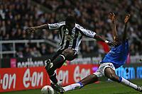 Photo: Andrew Unwin.<br /> Newcastle United v Birmingham City. The FA Cup. 17/01/2007.<br /> Birmingham's Fabrice Muamba (R) slides in on Newcastle's Obafemi Martins (L).