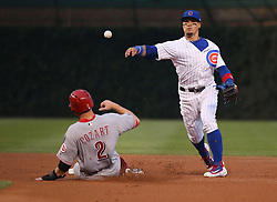 August 14, 2017 - Chicago, IL, USA - Chicago Cubs shortstop Javier Baez throws to first base on a fielder's choice, tagging out Cincinnati Reds shortstop Zack Cozart (2) during the first inning of their game at Wrigley Field Monday Aug. 14, 2017 in Chicago. (Credit Image: © Nuccio Dinuzzo/TNS via ZUMA Wire)