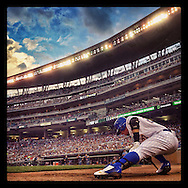 iPhone Instagram of Carlos Gomez of the Milwaukee Brewers warming up on-deck against the Minnesota Twins at Target Field in Minneapolis, Minnesota on June 5, 2014