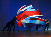 © Licensed to London News Pictures. 10/10/2012. Birmingham, UK  Stage hands reposition scenery featuring the conservative union flag logo on stage ahead of the Prime Ministers speech at The Conservative Party Conference at the ICC today 10th October 2012. Photo credit : Stephen Simpson/LNP