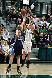 21 February 2015:  Moly McGraw shots over Fiona McMahon during an NCAA women's division 3 CCIW basketball game between the Elmhurst Bluejays and the Illinois Wesleyan Titans in Shirk Center, Bloomington IL