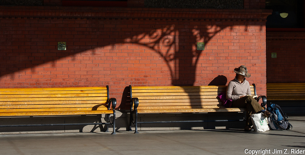 A woman waits at Union Station in Portland, Oregon.