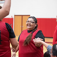 Sherietta Martinez, high-fiving her team members from Navajo Technical University, Saturday, Feb. 2 at NTU in Crownpoint in a staff and faculty basketball game between NTU and Diné College.