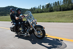 Maria and Jim Chandler on the Harley-Davidson Angels Ride to benefit the Nature Conservancy during the annual Sturgis Black Hills Motorcycle Rally.  SD, USA.  August 12, 2016.  Photography ©2016 Michael Lichter.
