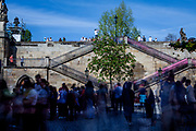 """Crowds of visitors moving from """"Kampa Island"""" up the stairs to Charles Bridge. Kampa is located in the Malá Strana (the Lesser Town) neighborhood of Prague."""