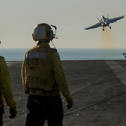USS John C Stennis CVN-74 Aircraft Carrier.Pic Shows  F-18 Super Hornets take of for their missions