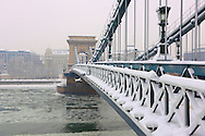North Side of the Szechenyi Lanchid (Chain Bridge) in the winter snow. Budapest Hungary.