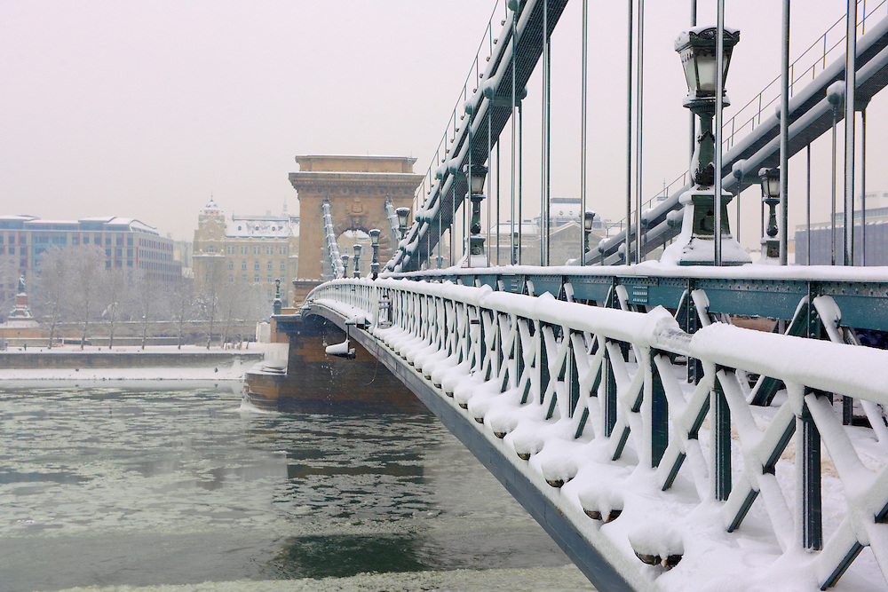 North Side of the Szechenyi Lanchid (Chain Bridge) in the winter snow. Budapest Hungary. .<br /> <br /> Visit our HUNGARY HISTORIC PLACES PHOTO COLLECTIONS for more photos to download or buy as wall art prints https://funkystock.photoshelter.com/gallery-collection/Pictures-Images-of-Hungary-Photos-of-Hungarian-Historic-Landmark-Sites/C0000Te8AnPgxjRg