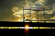 The sun sets as the Chicago Cubs play the Cincinnati Reds at Wrigley Field on June 11, 2013 in Chicago, Illinois. The Reds defeated the Cubs 12-2.