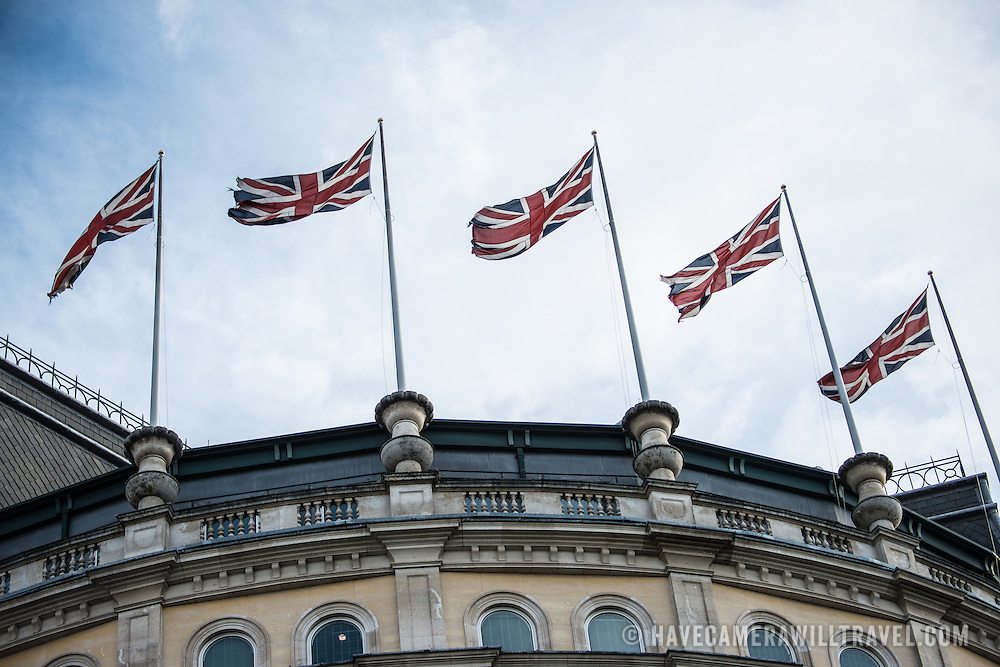 A row of British flags fly in the breeze above a buiilding in Charing Cross, opposite Trafalgar Square, in downtown London.