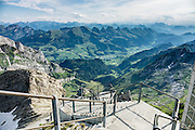 The limestone Churfirsten group forms a distinctive line of peaks the Appenzell Alps, in the Canton of St. Gallen, Switzerland, as seen from atop Säntis. Shared by three cantons, Säntis can be reached easily via Luftseilbahn Schwägalp-Säntis (aerial tramway) or with effort via trails, to see vast mountain views across six countries: Switzerland, Germany, Austria, Liechtenstein, France and Italy. The Appenzell Alps rise between Lake Walen and Lake Constance.