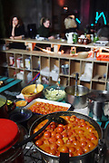 """Unsold tomatoes from Rungis market. Vegetables cooking for evening meal in kitchen<br /><br />The Freegan Pony is an alternative restaurant housed in a squat. It was founded in 2015 by Aladdin Charni with three other collaborators. The restaurant specialises in cheap vegetarian cuisine, serving meals which guests reserve a place through a Facebook group, paying €2 a meal. The restaurant meals contain unsold and donated food, collected from wholesellers at the Paris Rungis vegetable market. The Freegan Pony is located at the Porte de la Vilette on the outskirts of Paris, at the entrance to the peripherique outer circle motorway.<br /><br />Freegans are people who employ alternative strategies for living based on limited participation in the conventional economy and minimal consumption of resources. Freeganism is the practice of reclaiming and eating food that has been discarded. People who attempt to live an ethical lifestyle by reusing trash and rubbish thrown away by others.<br /><br />Freeganism is an ill-defined activity and is a subset of the larger anti-capitalist and environmental protest movements. It embraces alternative, anti-consumerist lifestyles. Freegan practices also include co-operative living, squatting and """"freecyling"""", or matching things that people want to get rid of with things other people need"""