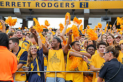 Sep 14, 2019; Morgantown, WV, USA; West Virginia Mountaineers fans celebrate after a touchdown during the first quarter against the North Carolina State Wolfpack at Mountaineer Field at Milan Puskar Stadium. Mandatory Credit: Ben Queen-USA TODAY Sports