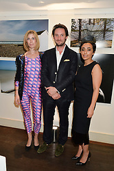 Left to right, ANNA PIA LUBINUS, J.HARRY EDMISTON and MASHAEL AL-RUSHAID founders of Heist at a private view and launch of the new Heist Gallery at 43 Linden Gardens, London W2 on 12th June 2014.