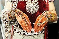 Pakistani Bride's hands adorned with jewellery on her arranged wedding day, Bradford.June 2012