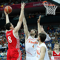 10 August 2012: Russia Sasha Kaun goes for the skyhook over Spain Pau Gasol during 67-59 Team Spain victory over Team Russia, during the men's basketball semi-finals, at the North Greenwich Arena, in London, Great Britain.