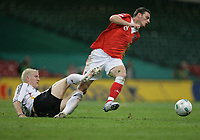 Photo: Rich Eaton.<br /> <br /> Wales v Germany. UEFA European Championships Qualifying. 08/09/2007. Germany's Bastian Schweinsteiger (L) tackles Jason Koumas.