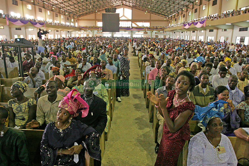 Jan 30, 2005; Ota, NIGERIA; Faith Tabernacle is reported to be the largest church auditorium in the world. With over 50,000 people present for services on any given Sunday, it also stands as one of the largest single congregations in the world. The church owns and operates 100 school buses which serve as transportation as its for it's 50,000 plus members. Dr. David O. Oyedepo (Ph.D)is the presiding Bishop over Living Faith Church worldwide and the Senior Pastor of Faith Tabernacle church. The ministry headquarters are located in Canaan Land, Ota, a border town between Lagos and Ogun State, Nigeria.