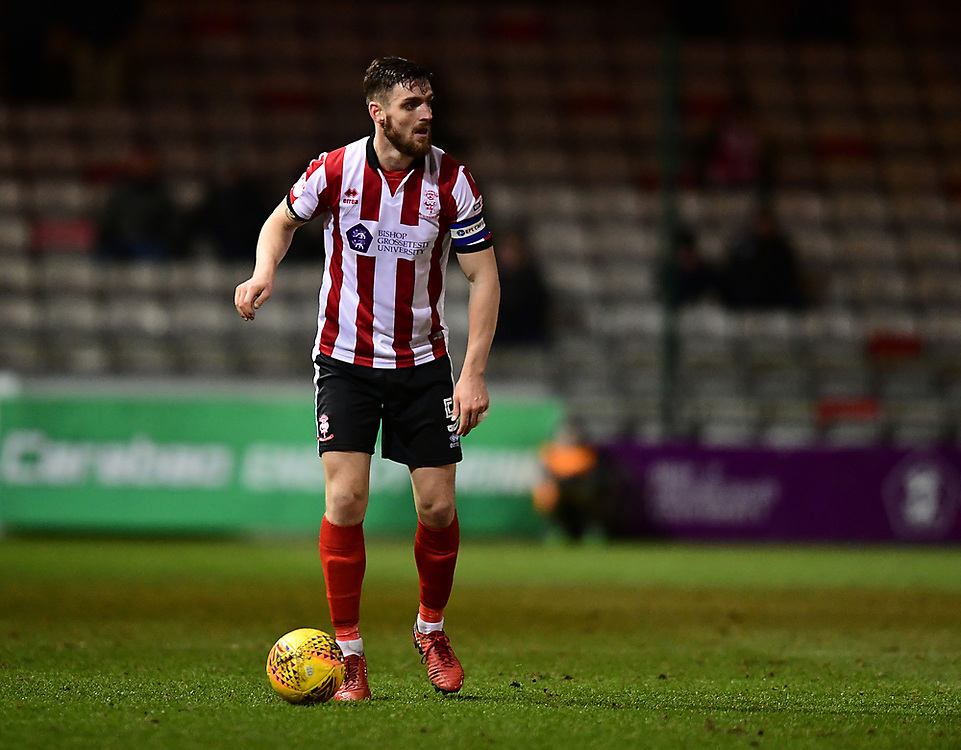 Lincoln City's Luke Waterfall<br /> <br /> Photographer Chris Vaughan/CameraSport<br /> <br /> The EFL Sky Bet League Two - Lincoln City v Cheltenham Town - Tuesday 13th February 2018 - Sincil Bank - Lincoln<br /> <br /> World Copyright © 2018 CameraSport. All rights reserved. 43 Linden Ave. Countesthorpe. Leicester. England. LE8 5PG - Tel: +44 (0) 116 277 4147 - admin@camerasport.com - www.camerasport.com