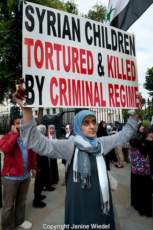 Syrians protesting for regime change at Downing Street Central London September 2011