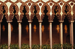 Europe, Italy, Salerno, Amalfi Coast, Ravello, collonade of stone arches with patterns of sunlight