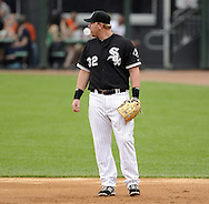 CHICAGO - JUNE 04:  Adam Dunn #33 of the Chicago White Sox blows a bubble while fielding against the Detroit Tigers on June 4, 2011 at U.S. Cellular Field in Chicago, Illinois.  The Tigers defeated the White Sox 4-2.  (Photo by Ron Vesely)  Subject:   Adam Dunn