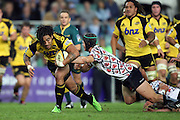 Ma'a Nonu taken by Berrick Barnes. NSW Waratahs v Hurricanes. 2010 Super 14 Rugby Union round 14 match played at the Sydney Football Stadium, Moore Park Australia. Friday 14 May 2010. Photo: Clay Cross/PHOTOSPORT