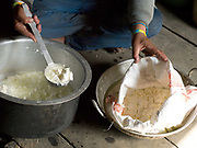 A Brokpa woman making 'Datse', a small handmade cheese made from cow's milk. Rural Bhutanese farmers make butter and cheese partly for storage or as a preserved form of milk for self consumption, with any excess being sold for cash or traded with neighbouring villages for daily necessities.