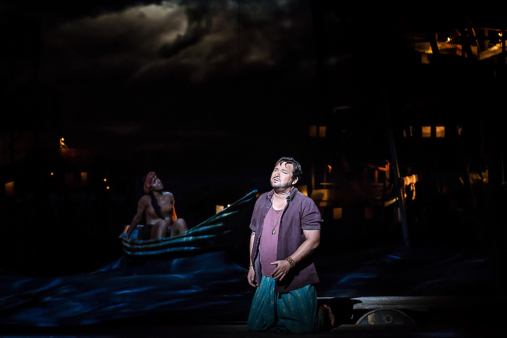 """LONDON, UK, 17 October, 2016.  Robert McPherson (in purple shirt, as """"Nadir"""") rehearses with a member of the cast for the revival of director Penny Woolcock's production of Bizet's opera """"The Pearl Fishers"""" at the London Coliseum for the English National Opera.  The production opens on 19 October."""