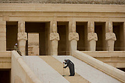 "A caretaker sweeps dusty steps at the otherwise deserted ancient Egyptian Temple of Hatshepsut near the Valley of the Kings, Luxor, Nile Valley, Egypt. According to the country's Ministry of Tourism, European visitors to Egypt is down by up to 80% in 2016 from the suspension of flights after the downing of the Russian airliner in Oct 2015. Euro-tourism accounts for 27% of the total flow and in total, tourism accounts for 11.3% of Egypt's GDP. The Mortuary Temple of Queen Hatshepsut, the Djeser-Djeseru, is located beneath cliffs at Deir el Bahari (""the Northern Monastery""). The mortuary temple is dedicated to the sun god Amon-Ra and is considered one of the ""incomparable monuments of ancient Egypt."" The temple was the site of the massacre of 62 people, mostly tourists, by Islamists on 17 November 1997."