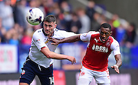 Bolton Wanderers's Gary Madine vies for possession with Fleetwood Town's Amari'i Bell<br /> <br /> Photographer Chris Vaughan/CameraSport<br /> <br /> Football - The EFL Sky Bet League One - Bolton Wanderers v Fleetwood Town - Saturday 20 August 2016 - Macron Stadium - Bolton<br /> <br /> World Copyright © 2016 CameraSport. All rights reserved. 43 Linden Ave. Countesthorpe. Leicester. England. LE8 5PG - Tel: +44 (0) 116 277 4147 - admin@camerasport.com - www.camerasport.com