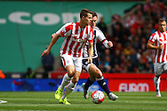 Marco van Ginkel of Stoke City being chased by Craig Gardner of West Bromwich Albion. Barclays Premier League match, Stoke city v West Bromwich Albion at the Britannia stadium in Stoke on Trent, Staffs on Saturday 29th August 2015.<br /> pic by Chris Stading, Andrew Orchard sports photography.