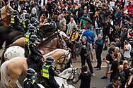 Huge numbers of riot and mounted branch police are seen preventing protesters from entering the CBD during the Melbourne Freedom Rally at The Shrine. Premier Daniel Andrews promises 'significant' easing of Stage 4 restrictions this weekend. This comes as only one new case of Coronavirus was unearthed over the past 24 hour and no deaths. (Photo by Dave Hewison/Speed Media)