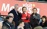 Former Manchester United Manager Sir Alex Ferguson is shown to his seat by Cardiff City owner Vincent Tan.<br /> Barclays Premier League match, Cardiff city v Manchester Utd at the Cardiff city stadium in Cardiff, South Wales on Sunday 24th Nov 2013. pic by Phil Rees, Andrew Orchard sports photography,