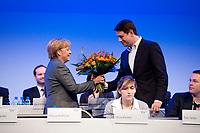 16 OCT 2010, POTSDAM/GERMANY:<br /> Angela Merkel (L), CDU, Bundeskanzlerin, bekommt zum Ende ihres BEsuches Blumen von Philipp Missfelder (R), MdB, Bundesvorsitzender Junge Union, Deutschlandtag der Jungen Union, Metropolis Halle, Filmpark Babelsberg<br /> IMAGE: 20101016-01-115<br /> KEYWORDS: Parteitag, party congress, Bundesparteitag, Philipp Mißfelder,