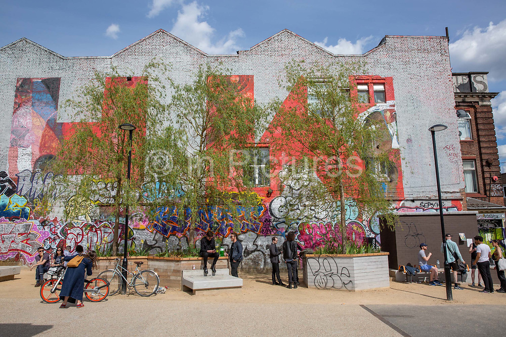 People gather outside Hackney Wick Overground Station on the 25th May 2019 in London in the United Kingdom.