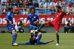 June 3, 2017 - Lisbon, Portugal - Portugal's midfielder Joao Moutinho (R ) fights for the ball with CyprusÂ«s defender Konstantinos Laifis during the friendly football match Portugal vs Cyprus at Antonio Coimbra da Mota Stadium in Estoril, outskirts of Lisbon, Portugal on June 3, 2017. Photo: Pedro Fiuza (Credit Image: © Pedro Fiuza via ZUMA Wire)