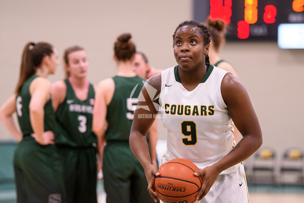 1st year guard Kyanna Giles (9) of the Regina Cougars in action during the home game on December  2 at Centre for Kinesiology, Health and Sport. Credit: Arthur Ward/Arthur Images