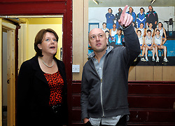 © Licensed to London News Pictures. 19/02/2013. Bristol, UK. Maria Miller the Secretary of State for Culture Media and Sport, talks to Club Secretary Martin Bisp on a visit to the Empire Boxing Club in St Pauls, Bristol.  The Secretary of State is keen to build on the momentum of the Olympics and get more girls and women playing sport.  19 February 2013..Photo credit : Simon Chapman/LNP