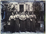 happy smiling domestic servants and maids group portrait France 1930s