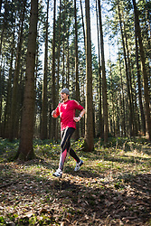 Man jogging on fitness trail in nature