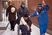 Moscow, Russia, 18/01/2006..A homeless man suffering from the cold is brought to a city hospital by emergency services. A Siberian weather front has brought temperatures down to minus 36C in the Russian capital and led to power cuts in the city.
