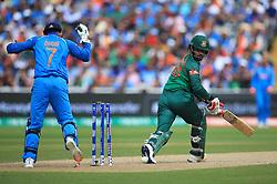 Bangladesh's Tamim Iqbal is bowled by India's Kedar Jadhav during the ICC Champions Trophy, semi-final match at Edgbaston, Birmingham.