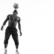 FRANCE. Paris, Ile-de-France. December 8th, 2014. Athlete Iya Traoré, performs a dance with a soccer ball in Montmartre.
