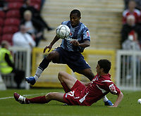 Photo: Jonathan Butler.<br /> Swindon Town v Charlton Athletic. The Carling Cup. 14/08/2007.<br /> Ben Tozer of Swindon tackles Yassin Moutaouakil of Charlton.