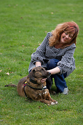 © Licensed to London News Pictures. 21/02/2013. London, UK. Brin, a mongrel from Afghanistan that survived capture by the Taliban and saved the life of two soldiers by alerting them to a hidden bomb in Helmand, is seen with his owner Sally Baldwin, at the photocall for the finalists of the 'Friends for Life' competition in London today (21/02/2013). The Kennel Club's 'Friends for Life' competition, which has been running since 2006, celebrates heart-warming stories of friendship in adversity, the dog that the public votes as the winner will be presented with a trophy in the main arena during Crufts at the Birmingham NEC on the 10th March. Photo credit: Matt Cetti-Roberts/LNP